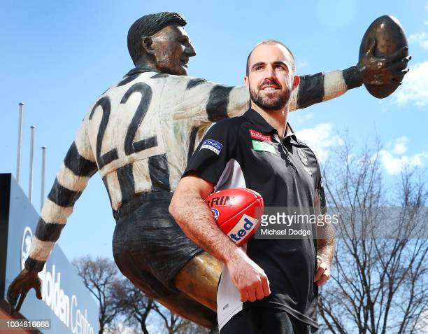 Steele Sidebottom of the Magpies poses in front of the Bob Rose statue during a Collingwood Magpies AFL media oportunity at Holden Centre on...