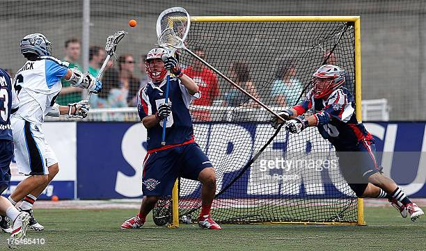 Steele Stanwick of the Ohio Machine shoots on Jordan Burke of the Boston Cannons in the second half at Harvard Stadium on August 3 2013 in Boston...
