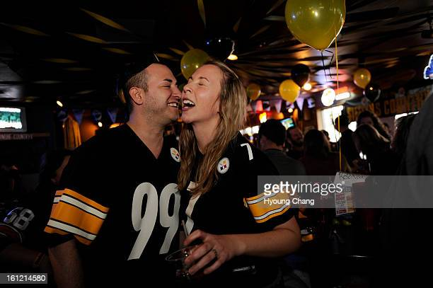 Steeler's fan Brandon Kohn from New York left and his wife Cilia are in Steeler Stampede Rally at the Rusty Bucket in Lakewood Colorado Saturday...