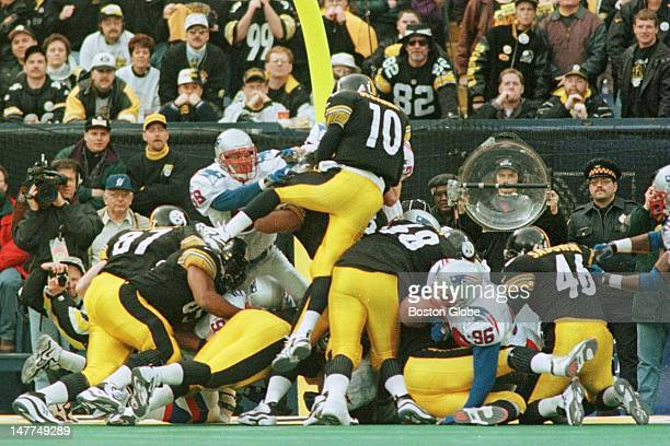 Steelers quarterback Kordell Stewart is stuffed by the Patriots as he tries to score on fourth and one late fourth quarter They turned it over on...