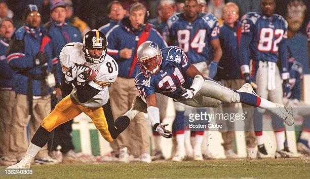 Steelers receiver Charles Johnson catches a pass as he is defended by New England Patriots Jimmy Hitchcock during the fourth quarter of Saturday's...