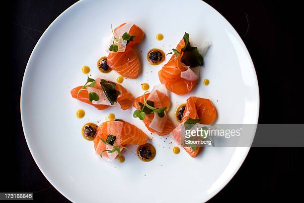 Steelhead salmon is served at Manon restaurant in New York US on Monday June 24 2013 The dish comes with pickled daikon wakame and burnt miso...