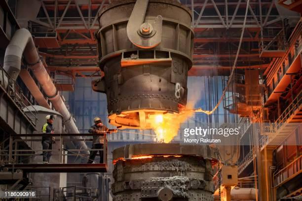 steelworker starting molten steel pour in steelworks - 検査業務 開始の地 ストックフォトと画像