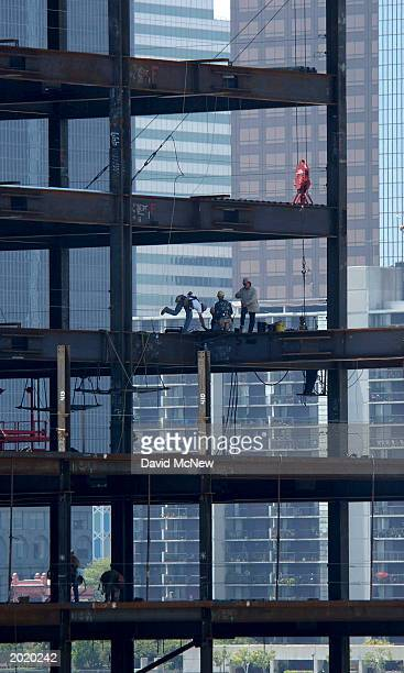 Steelworkers construct a downtown highrise on May 21 2003 in Los Angeles California A Census Bureau survey released May 19 reports that about 782...