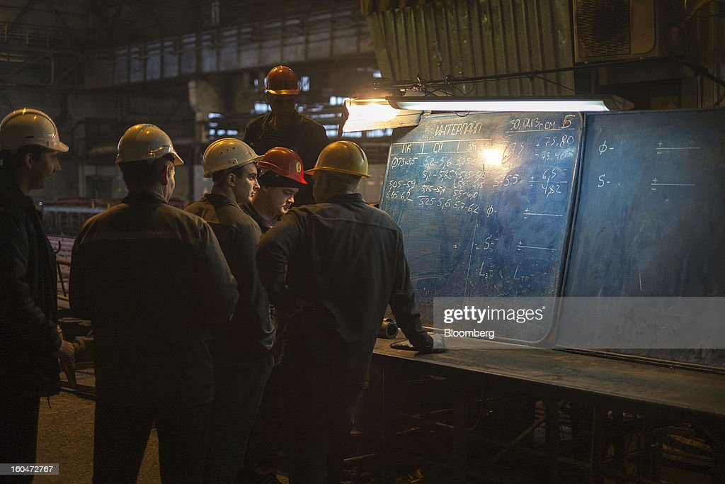 Steelworkers discuss production and quality control issues at the Interpipe LLC plant in Dnipropetrovsk, Ukraine, on Wednesday, Jan. 30, 2013. Ukraine's Interpipe Group, owned by billionaire Victor Pinchuk, opened a $700 million electric steel mill in Dnipropetrovsk with an annual output capacity of 1.32 million tons of steel for its seamless pipe production. Photographer: Vincent Mundy/Bloomberg via Getty Images