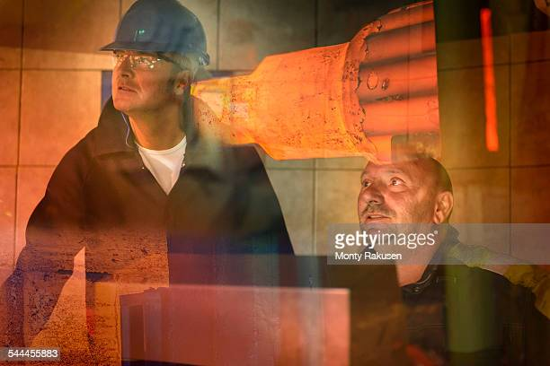 Steelworkers in forging press control room