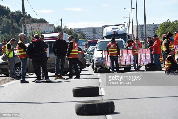 Steelworkers of French steel maker Ascometal block the road to protest against the controversial labour reform bill on May 19 2016 on the D568...