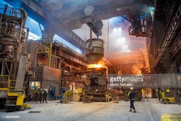 steelworkers pouring molten steel in melt shop of steelworks - plant stock pictures, royalty-free photos & images