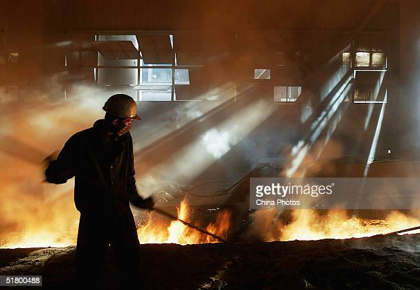 Steelworkers Work At A Steel Mill Of The Baotou Iron And Steel Group
