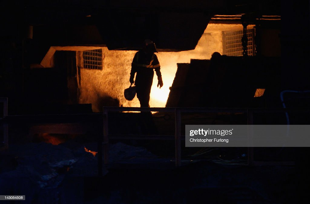 Steelworkers work at the face of the furnace at the SSI iron furnace after making its first steel slab in two years on April 18, 2012 in Redcar, England. The former Corus owned furnace was mothballed two years ago but was bought by Thai firm Sahaviriya Steel Industries (SSI) who have given jobs back to many of the 1,600 workers who lost their jobs.