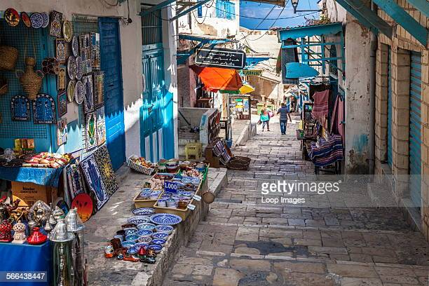 Steep and narrow street in the souk area of the medina in Sousse in Tunisia