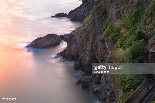 steep coastline and sea at sunset, italy - image foto e immagini stock