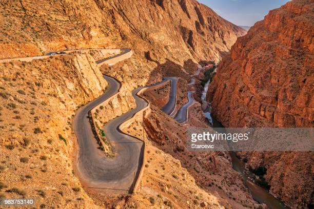 steep mountain road - dades valley morocco - steep stock photos and pictures
