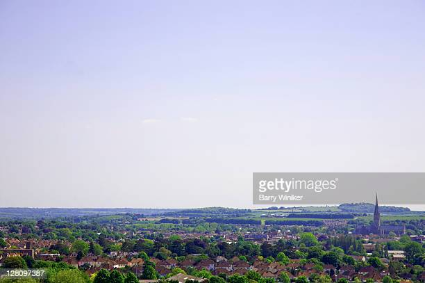 steeple of salisbury cathedral, right, above residences, united kingdom - サリスベリー ストックフォトと画像