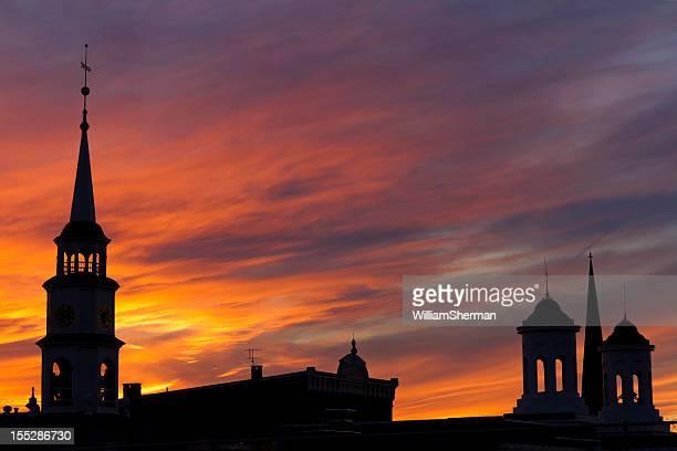 Steeple Silhouettes Against a Blazing Orange Sunset