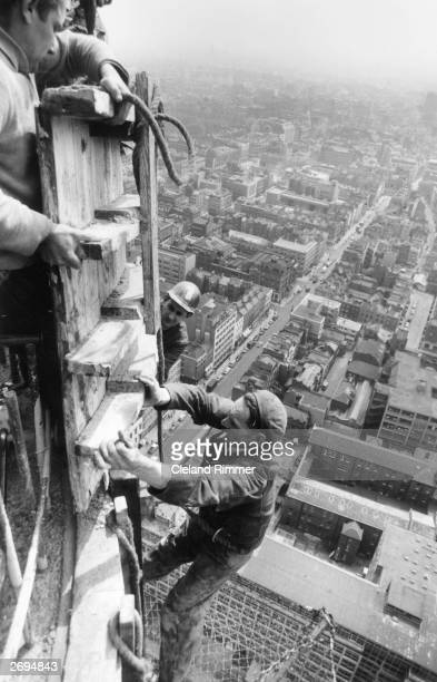 Steeplejacks constructing the GPO Tower in central London.