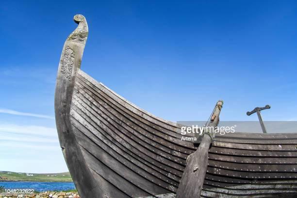 Steering oar at stern of Skidbladner, full size replica of the Gokstad ship at Brookpoint, Unst, Shetland Islands, Scotland, UK.