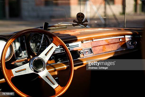Steering wheel and dashboard of a vintage car