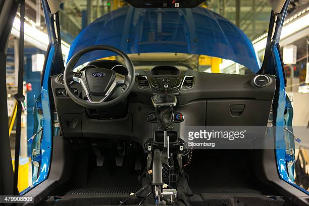 A steering wheel and dashboard sit inside a Ford Fiesta automobile on the production line at the Ford Motor Co factory in Cologne Germany on Friday...