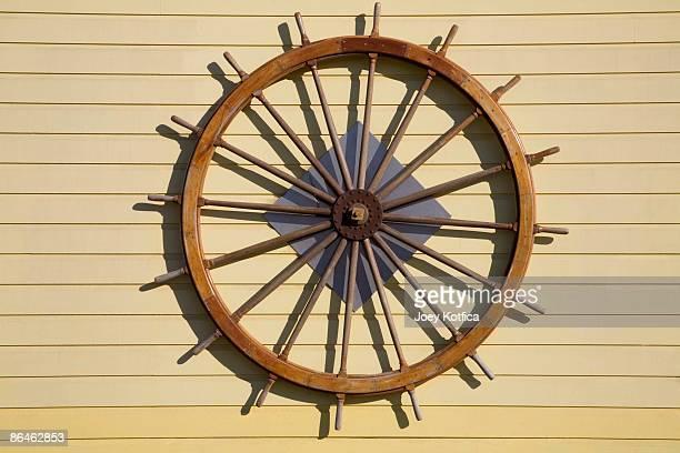 Steering wheel of ship hanging on wall
