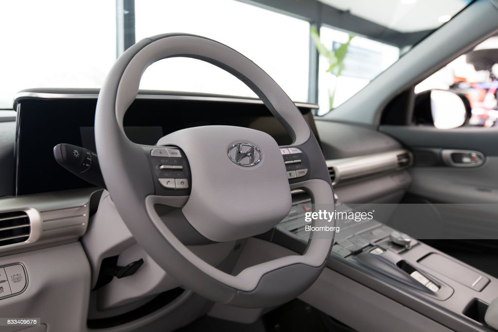 A steering wheel of the Hyundai Motor Co. next generation fuel-cell electric sport utility vehicle (SUV) is seen during an unveiling event in Seoul, South Korea, on Thursday, Aug. 17, 2017. Hyundai said that electric vehicles will underpin its push into environmentally friendly cars, the latest automaker to embrace battery-powered vehicles after earlier bets on hydrogen fuel-cell cars. Photographer: SeongJoon Cho/Bloomberg via Getty Images