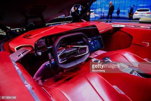 Steering wheel sits on the dashboard of a new Renault Trezor concept automobile, produced by Renault SA, during the second press day of the Paris...