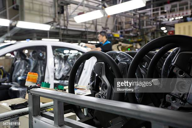 Steering wheels for Hyundai Motor Co. Elantra vehicles sit on the production line at the company's plant in Ulsan, South Korea, on Monday, July 4,...