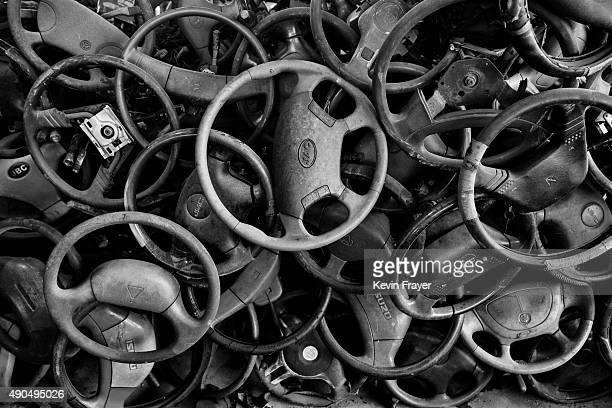 Steering wheels from high polluting vehicles taken off the road by authorities are seen piled up at an auto scrapyard on September 25 2015 in...