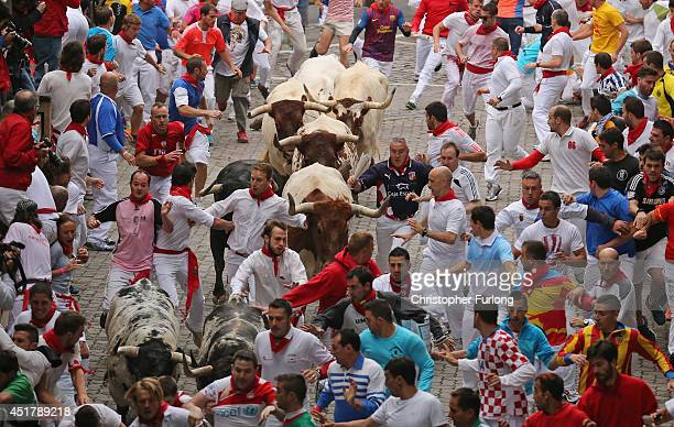 Steers and bulls from the Ranch of Torrestrella enter the bullring during the second day of the San Fermin Running Of The Bulls festival on July 7...