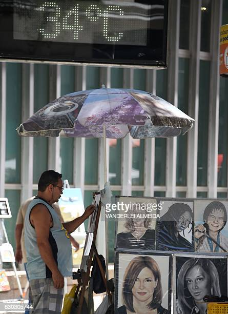 A steet digital clock marks 34 degrees Celsius in the center of Rio de Janeiro Brazil on December 20 2016 during the last day of spring anticipating...