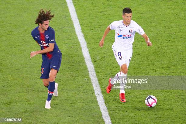 Stef Peeters of SM Caen and Adrien Rabiot of Paris Saint Germain during the French Ligue 1 match between Paris Saint Germain and Caen at Parc des...