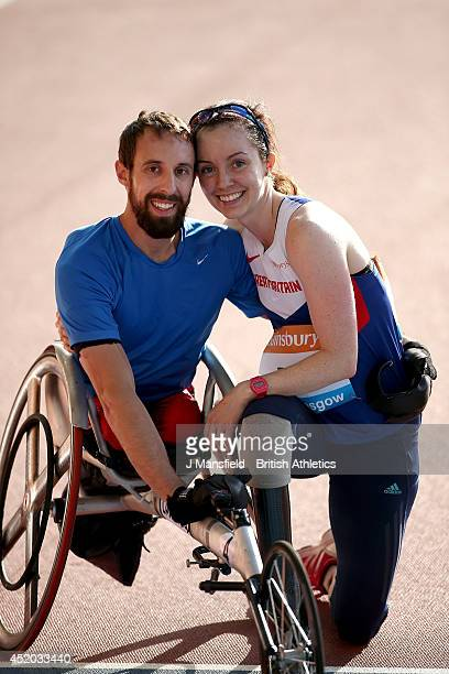 Stef Reid of Great Britain poses with her partner Brent Lakatos of Canada after they compete in the IAAF Diamond League Day 1 at Hampden Park on July...