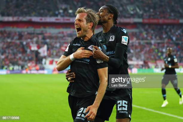 Stefan Aigner of 1860 Muenchen celebrates his team's first goal with team mate Abdoulaye Ba during the Second Bundesliga match between Fortuna...