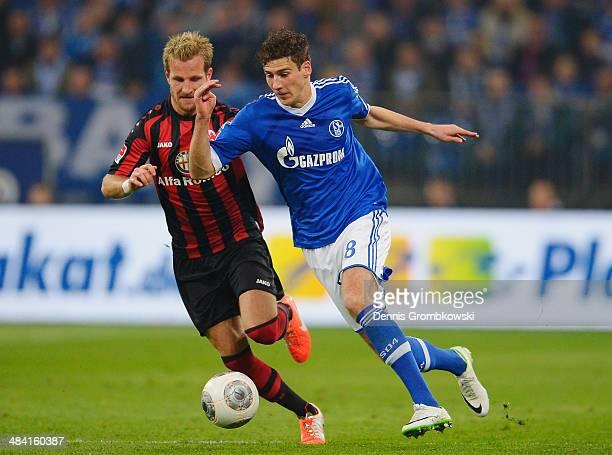 Stefan Aigner of Eintracht Frankfurt and Leon Goretzka of FC Schalke 04 battle for the ball during the Bundesliga match between FC Schalke 04 and...