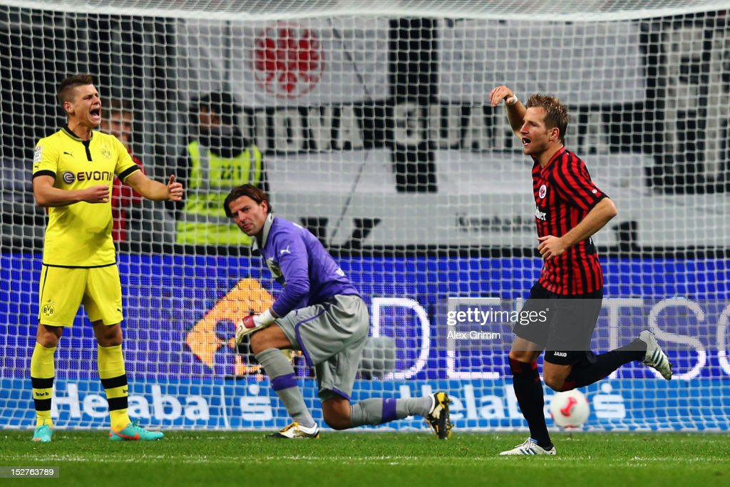 Stefan Aigner of Frankfurt celebrates his team's first goal as goalkeeper Roman Weidenfeller and Lukasz Piszczek (R-L) of Dortmund react during the Bundesliga match between Eintracht Frankfurt and Borussia Dortmund at Commerzbank-Arena on September 25, 2012 in Frankfurt am Main, Germany.