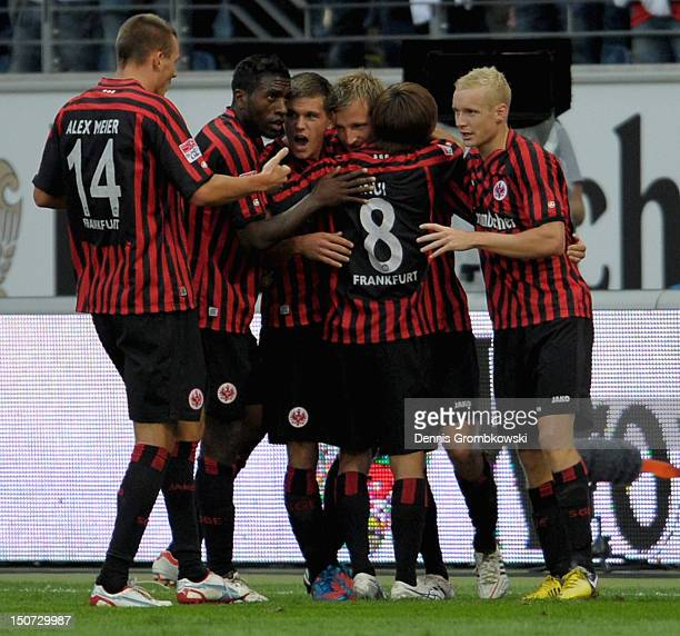 Stefan Aigner of Frankfurt celebrates with teammates after scoring his team's second goal during the Bundesliga match between Eintracht Frankfurt and...