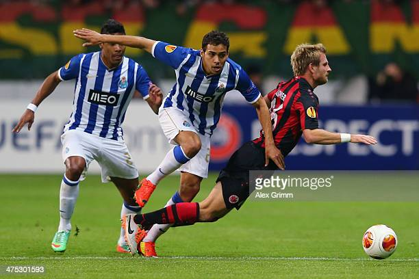 Stefan Aigner of Frankfurt is challenged by Carlos Eduardo and Alex Sandro of Porto during the UEFA Europa League Round of 32 second leg match...