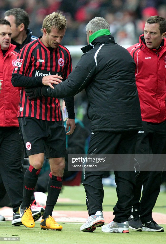 Stefan Aigner of Frankfurt leaves the pitch injured towards head coach Armin Veh of Frankfurt during the Bundesliga match between Eintracht Frankfurt and 1899 Hoffenheim at Commerzbank-Arena on January 26, 2013 in Frankfurt am Main, Germany.
