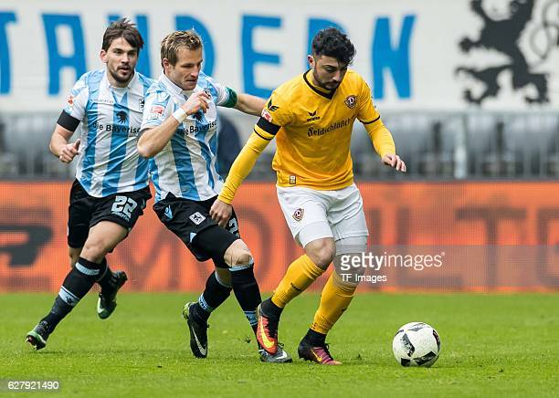 Stefan Aigner of TSV 1860 Muenchen and Aias Aosman of Dynamo Dresden battle for the ball during the Second Bandesliga match between TSV 1860 Muenchen...