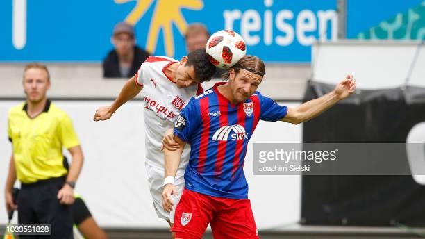 Stefan Aigner of Uerdingen challenges Niklas Landgraf of Halle during the 3 Liga match between KFC Uerdingen 05 and Hallescher FC at...