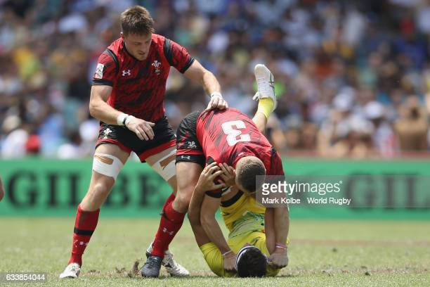 Stefan Andrews of Wales and Mick Adams of Australia scuffle during the Quarter final match between Australia and Wales in the 2017 HSBC Sydney Sevens...