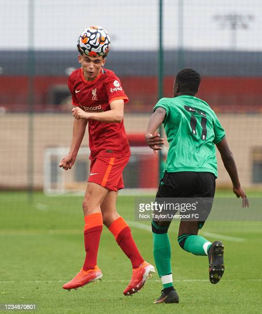 Stefan Bajcetic of Liverpool and Matthew Lusakueno of Stoke City in action during the U18 Premier League game at AXA Training Centre on August 14,...