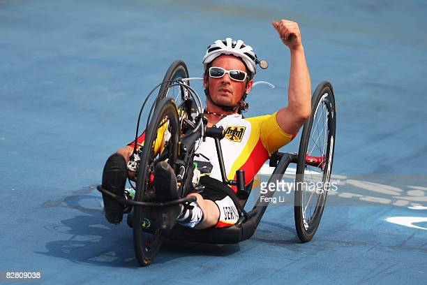 Stefan Baumann of Germany celebrates after reaching the finish line in the Road Cycling Men's Road Race the Triathlon Venue during day eight of the...