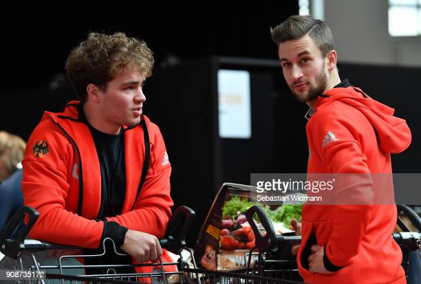 Stefan Baumeister and Markus Eisenbichler talk during the 2018 PyeongChang Olympic Games German Team kit handover at Postpalast on January 22 2018 in...