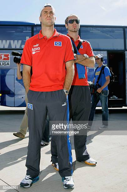 Stefan Beinlich and Sergej Barbarez of Hamburger SV arrive after winning the UEFA Intertoto Cup Final against FC Valencia at the Fuhlsbuettel Airport...