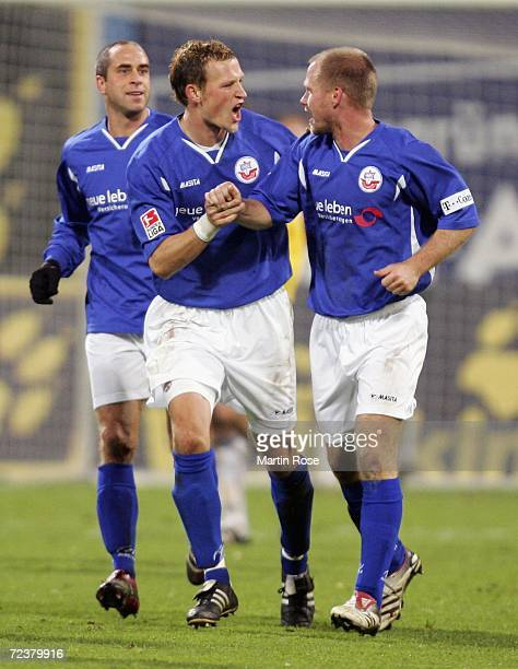Stefan Beinlich Marcel Schied and Rene Rydlewicz of Rostock celebrates the 1st goal during the Second Bundesliga match between Hansa Rostock and Carl...