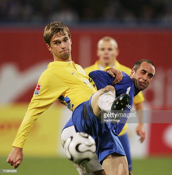 Stefan Beinlich of Rostock and Fiete Sykora of Jena fight for the ball during the Second Bundesliga match between Hansa Rostock and Carl Zeiss Jena...