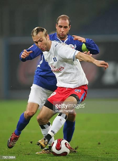 Stefan Beinlich of Rostock challenges Danjel Ljuboja of Hamburger SV during the friendly match bewteen Hansa Rostock and Hamburger SV at the Ostsee...