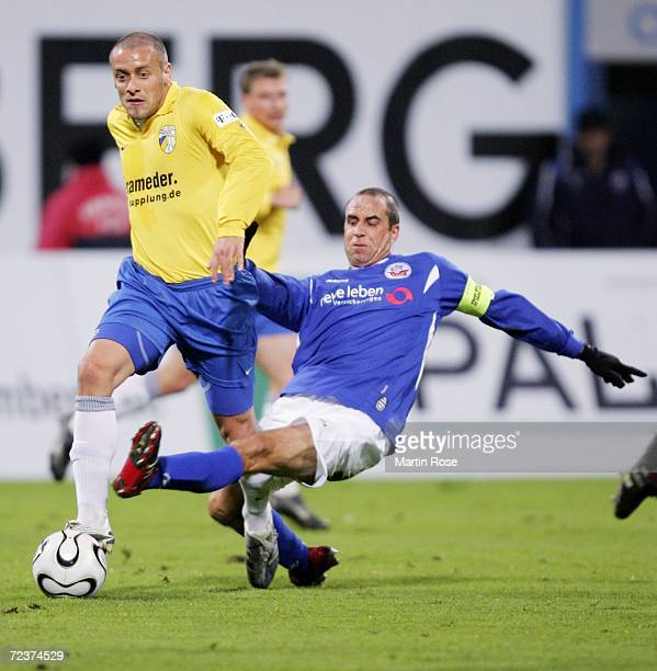 Stefan Beinlich of Rostock tries to stop Patrick de Napoli of Jena during the Second Bundesliga match between Hansa Rostock and Carl Zeiss Jena at...