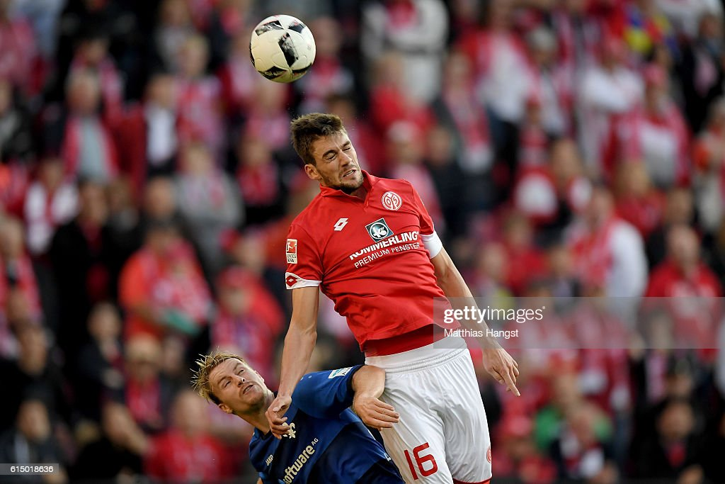 Stefan Bell (R) of Mainz and Fabian Holland of Darmstadt battle for the ball during the Bundesliga match between 1. FSV Mainz 05 and SV Darmstadt 98 at Opel Arena on October 16, 2016 in Mainz, Germany.